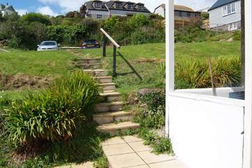 The steps leading down from the parking-area to the cottage.