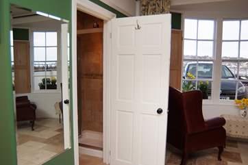 The door into the shower-room.
