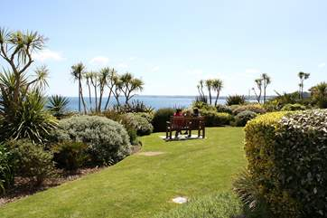 A perfectly placed bench allows you to admire the view from the communal garden in comfort!