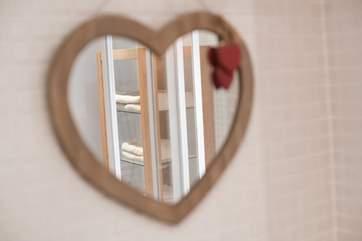 A pretty mirror in the bathroom.