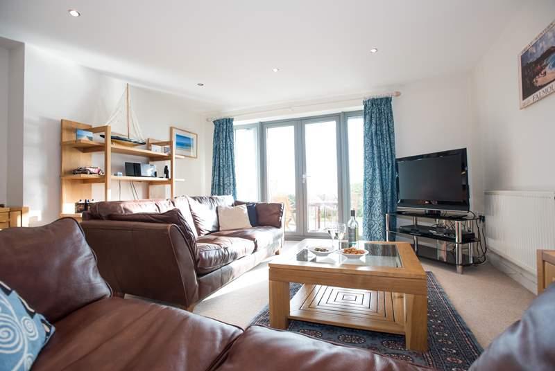 The light-fillied living-room.