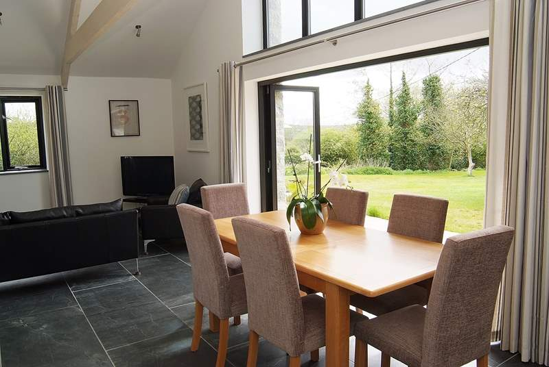 The large bi-fold doors open out to the patio and garden.