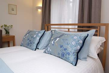 White crisp bed linen is used throughout the property.