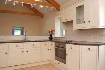 The kitchen area of the open plan living-room.