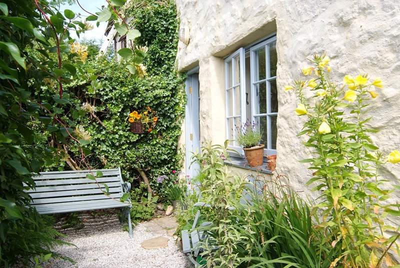 The pretty rear courtyard, the perfect place to relax.