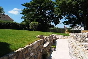 A little stone seat has been built into one of the retaining walls.