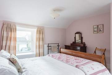 With two windows, the double bedroom is lovely and light.
