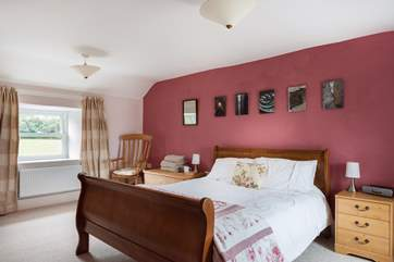 Spacious Bedroom 1 is furnished with a king-size sleigh bed.