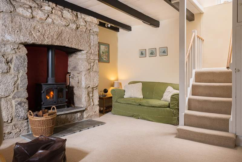 The snug which has stairs to the first floor, has a warming wood-burner in the old stone inglenook which is perfect for those cooler evenings.