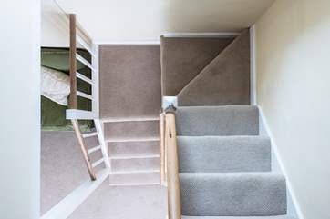 The staircase is typical of an older cottage, fairly steep and turning half way up - mind your head if you're tall!