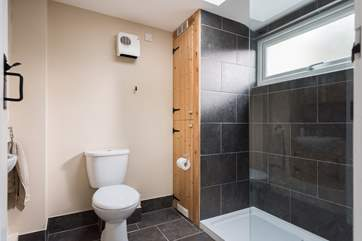 The shower-room is on the ground floor and has a large double cubicle.