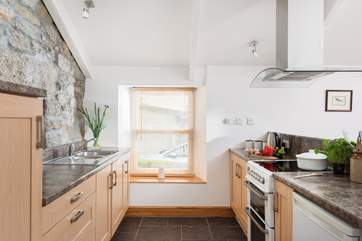 The kitchen is well designed, modernised in harmony with the character of the cottage.