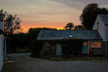 The sun setting slowly in the west behind Medlar Cottage.