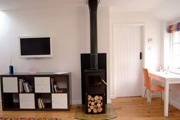 The wood-burner in the sitting-area.