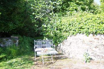 The cottage has its own sitting-area in a sunny corner of the courtyard.
