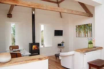 The sitting/dining side of the open plan living-room in this lovely single-storey cottage.