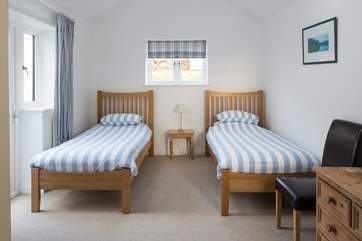 The twin bedroom has a door out to the raised garden at the back of the house.