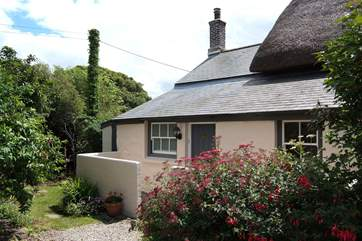 A path leads round each side of the cottage to the back garden (please take care on the steps).