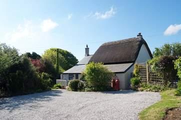 There is plenty of parking space in front of the cottage, with a five-barred gate at the entrance.