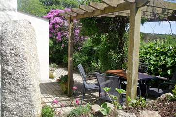 The pretty outside terrace is a lovely spot to sit and read or enjoy the company of friends and family.