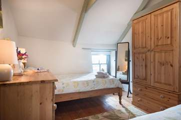 The comfortable twin bedroom also has views across the surrounding fields.