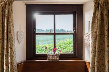 Views from the dining-room across the fields behind the cottage.