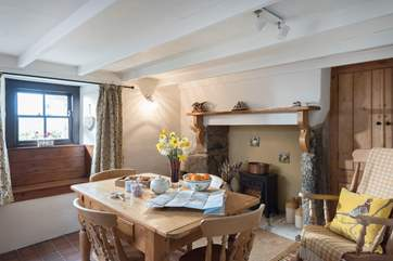 The dining-room has a feature fireplace with an electric stove and a rocking chair.
