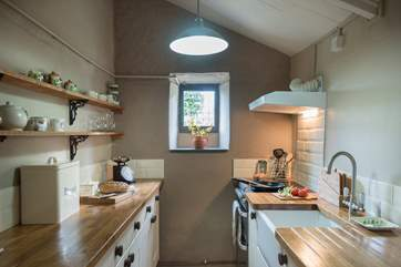 The cottage has a well-equipped galley-style kitchen.