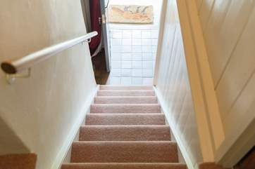 The cottage stairs are typically steep but not narrow and there is a hand rail all the way up to the split landing at the top.