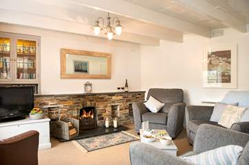 The sitting room has an open fire making this a perfect retreat all year round