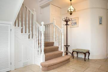 The spacious entrance hall and grand staircase.