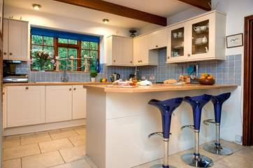 The kitchen has a breakfast-bar, ideal for an informal breakfast or a morning coffee.