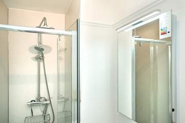 The bright and shiny en suite shower-room