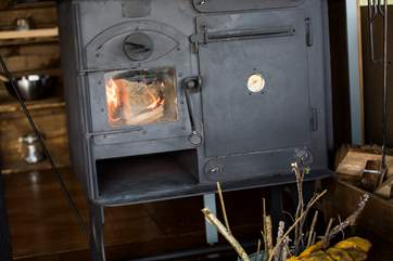 The wood-fired range doubles up as your heating and cooking appliance.