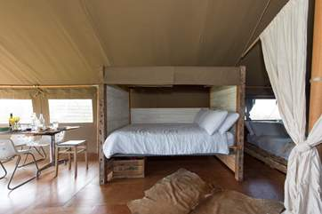 The double cabin bed with luxurious linens.