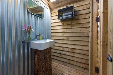 The cloakroom has a WC and wash-basin.