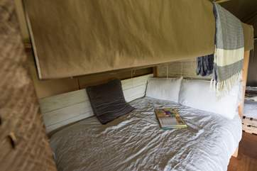 Woody's lovely double cabin bed with luxurious linens.