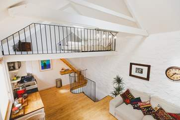 The first floor living-area has steep steps up to the second floor mezzanine snug.
