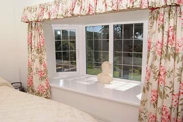 The master bedroom has this lovely wide window sill looking out to the front of the cottage.
