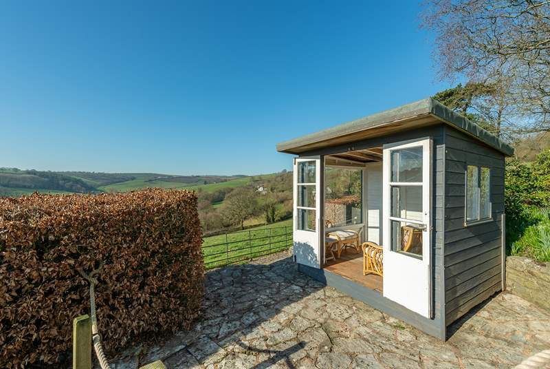 The summer house is the perfect place to sit with a glass of wine watching the deer come out to graze across the valley