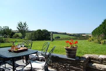 The patio-area outside the cottage catches the sun and offers lovely rural views.