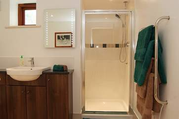 The ground floor family bathroom has a free-standing bath and separate shower cubicle.