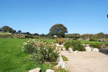 The cottage has a very large lawned garden and gravelled sitting-area.