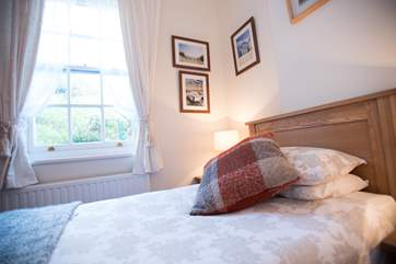 The tall sash window looks out to the rear terrace.