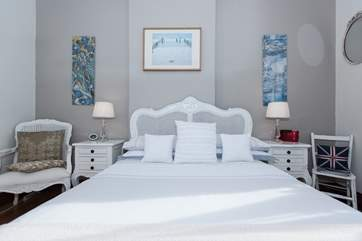 The beautiful bed in Bedroom 1.