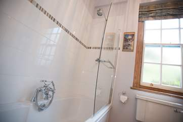 There is a fitted shower over the bath as well as a hand-held shower attachment.