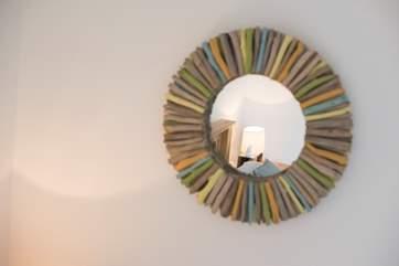A handmade driftwood mirror.