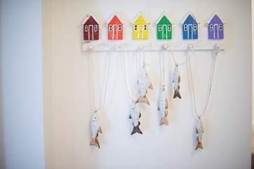 Children will love the seaside coat pegs.