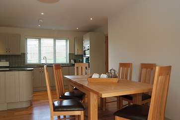 The dining-area links the kitchen and sitting-areas.