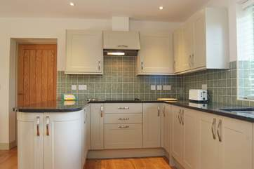 There are bespoke granite work surfaces in the kitchen.